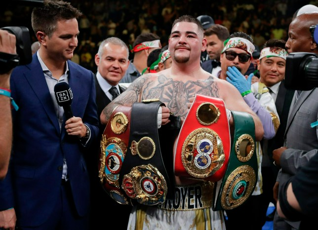 FILE - In this Saturday, June 1, 2019, file photo, Andy Ruiz poses with championship belts after defeating Anthony Joshua to capture the unified world heavyweight title. Ruiz has become a folk hero overnight among people of Mexican ancestry in the United States. (AP Photo/Frank Franklin II, File)