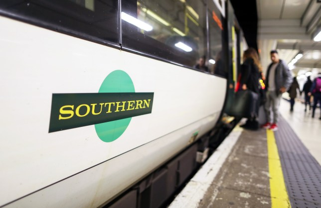 Passengers board a Southern Rail train, during strike action by Southern Rail conductors, at London Victoria railway station in London, U.K., on Monday, Dec. 19, 2016. It is one of a number of industrial disputes that have hit the U.K. this holiday season, with strikes scheduled for the mail service, airport baggage handling and British Airways Plc cabin crew. Photographer: Chris Ratcliffe/Bloomberg via Getty Images