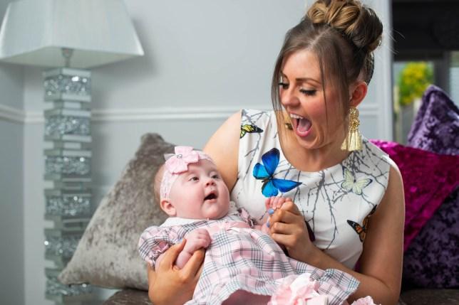 Mum Natalie holding baby Maribelle who has spina bifida