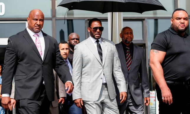 Singer R. Kelly leaves the Leighton Criminal Court Building after a hearing on sexual abuse charges on June 6, 2019, in Chicago. - Chicago prosecutors on Thursday filed 11 felony sex crime charges against Kelly, in what his lawyer said was a refiling of counts from an existing case. Robert Kelly, 52, is already facing 10 felony counts, filed in February, for the alleged abuse of four women. (Photo by KAMIL KRZACZYNSKI / AFP)KAMIL KRZACZYNSKI/AFP/Getty Images