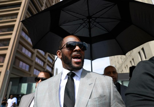 Musician R. Kelly departs the Leighton Criminal Court building after pleading not guilty to 11 additional sex-related charges