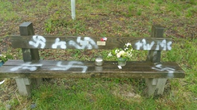 Undated handout photo issued by Lincolnshire Police of a commemorative bench which has been spray painted with a swastika in Twyford Woods, Lincolnshire, a site which was used as an airfield in the Second World War for aircraft to take off for Normandy ahead of D-Day. PRESS ASSOCIATION Photo. Issue date: Monday June 10, 2019. See PA story POLICE Swastika. Photo credit should read: Lincolnshire Police/PA Wire NOTE TO EDITORS: This handout photo may only be used in for editorial reporting purposes for the contemporaneous illustration of events, things or the people in the image or facts mentioned in the caption. Reuse of the picture may require further permission from the copyright holder.