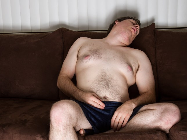 Fat guy topless asleep on the couch