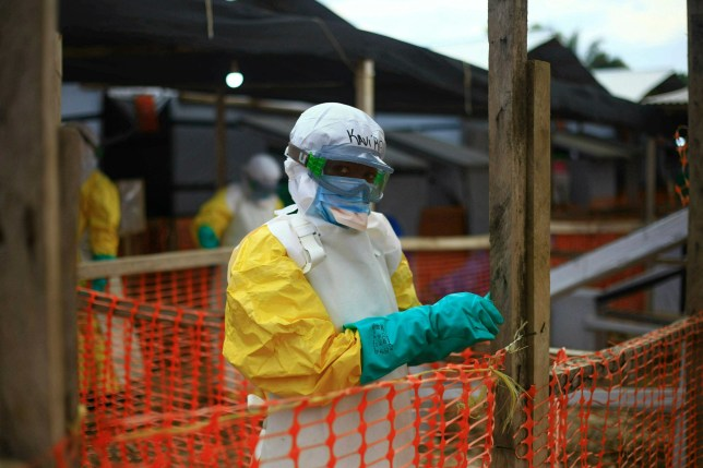 FILE - This Tuesday, April, 16, 2019 file photo taken in Congo shows an Ebola health worker at a treatment center in Beni, Eastern Congo. Uganda's health ministry said late Tuesday, June 11, 2019 that a 5-year-old Congolese boy who crossed into Uganda has tested positive for Ebola in what is the first cross-border case of the deadly virus since an outbreak started in neighboring Congo last year. (AP Photo/Al-hadji Kudra Maliro, File)