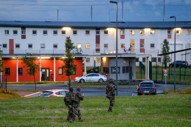 French soldiers patrol in front of the penitentiary center of Alencon, in Conde-sur-Sarthe, northwestern France, as a hostage-taking is underway late on June 11, 2019. (Photo by JEAN-FRANCOIS MONIER / AFP)JEAN-FRANCOIS MONIER/AFP/Getty Images