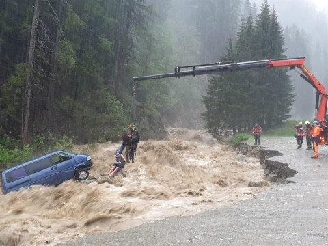 Sleeping tourists rescued from river after flash flood swept van away