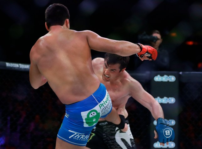 Brazil's Lyoto Machida, left, kicks Chael Sonnen during the first round of a light heavyweight mixed martial arts bout at Bellator 222 early Saturday, June 15, 2019, in New York. Machida stopped Sonnen in the second round. (AP Photo/Frank Franklin II)