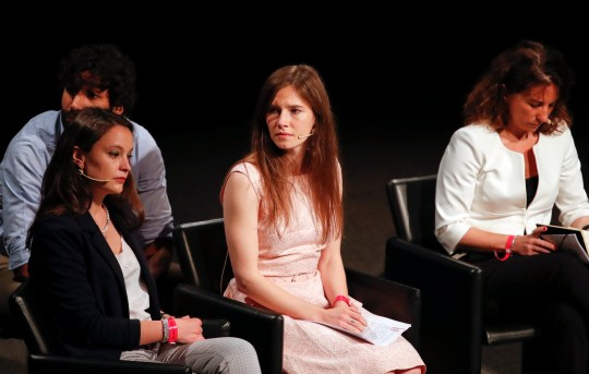 Amanda Knox, center, attends a Criminal Justice Festival at the University of Modena, Italy