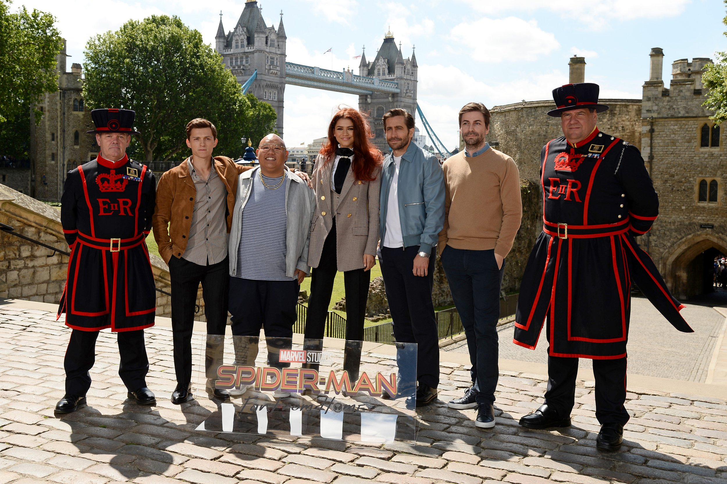 LONDON, ENGLAND - JUNE 17: A Yeoman Warder, Tom Holland (Peter Parker / Spiderman), Jacob Batalon (Ned Leeds), Zendaya (MJ), Jake Gyllenhaal (Quentin Beck / Mysterio), Director Jon Watts and A Yeoman Warder attend a Spider-Man: Far From Home London print call during Tower of London one of a films iconic locations on Jun 17, 2019 in London, England. (Photo by Jeff Spicer/Getty Images for Sony)