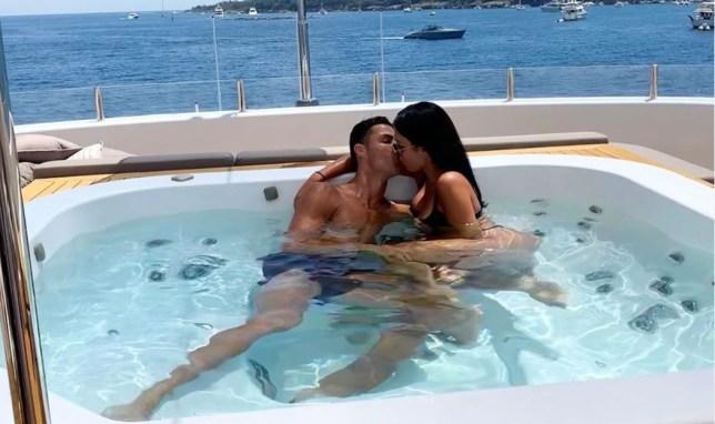 Cristiano Ronaldo kisses girlfriend Georgina Rodriguez on yacht
