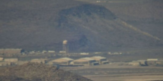 What appear to be large hangars could be seen at the base (Picture: UFO Seekers)