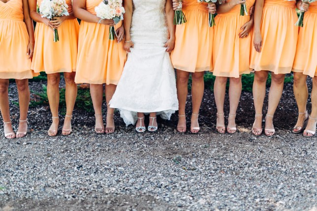 Bridesmaids standing with the bride