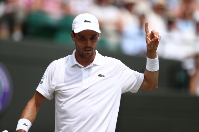 Roberto Bautista Agut puts his finger to the sky during his quarter-final win at Wimbledon