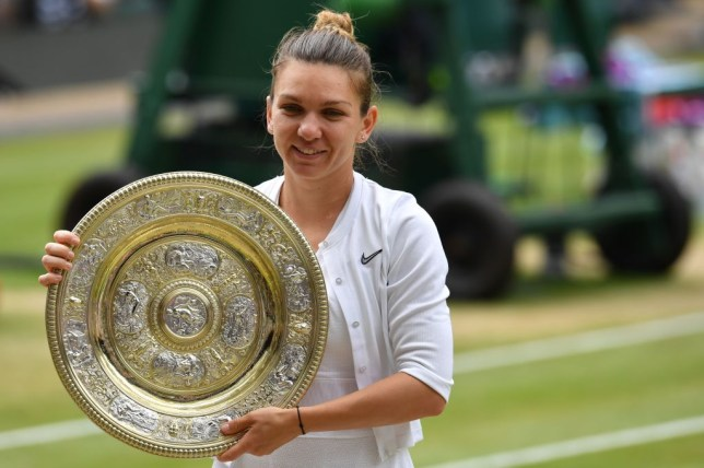 Simona Halep with the Wimbledon title after her win against Serena Williams