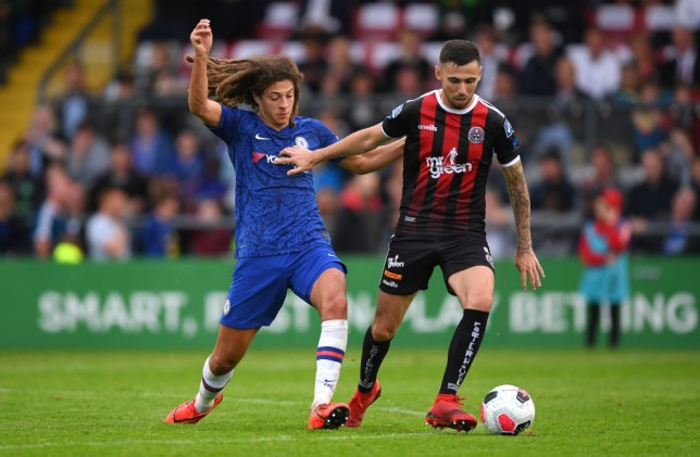 Ethan Ampadu makes a tackle for Chelsea against Bohemians