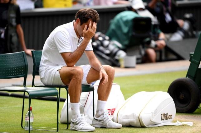 Roger Federer cuts a devastated figure after his Wimbledon defeat