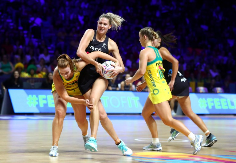 Shannon Saunders of New Zealand and Stephanie Wood from Australia struggle for the ball at the final of the Vitality Netball World Cup in Liverpool
