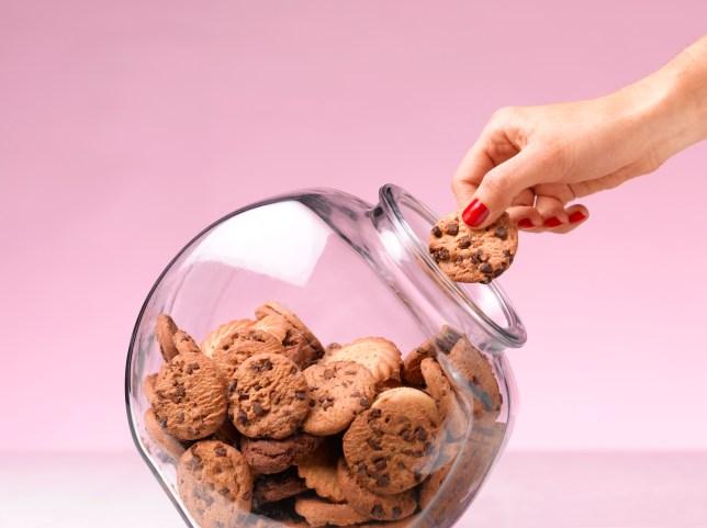 Cookies being taken from a jar