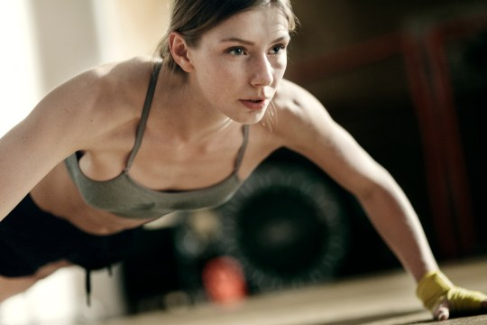 A woman doing a wide grip press-up