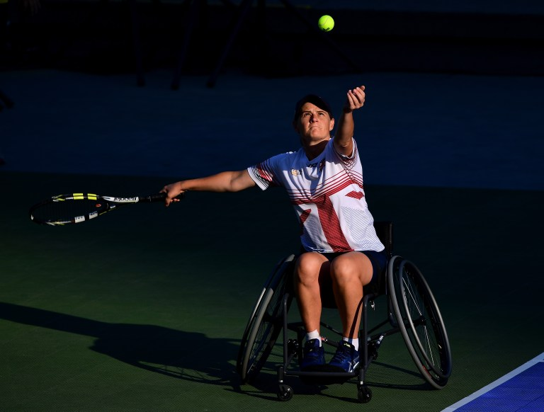 Cornelia Oosthuizen serving in a wheelchair tennis match
