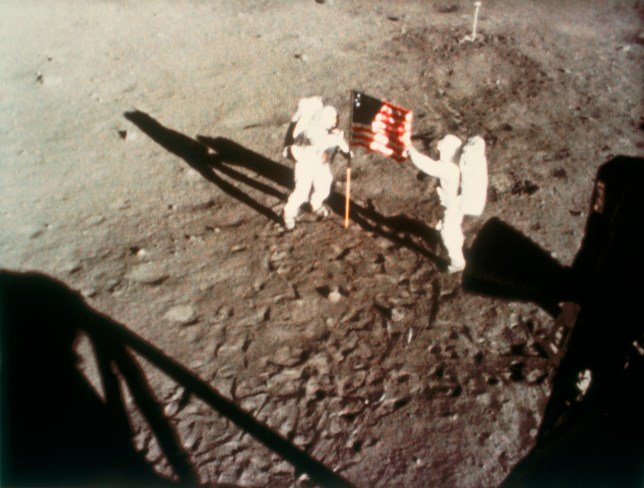 Neil Armstrong and Buzz Aldrin planing the American flag on the moon in 1969 (Photo by SSPL/Getty Images)