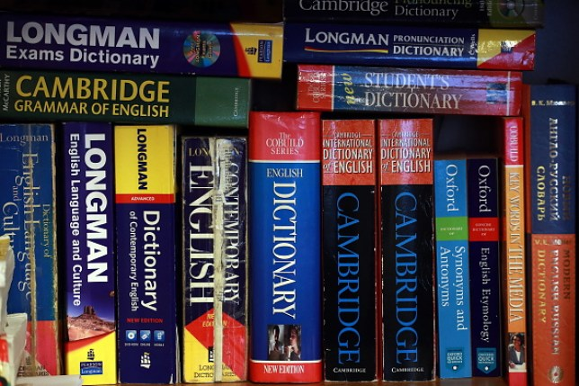 A shelf full of different versions of the Oxford English Dictionaries