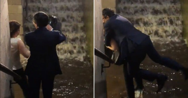 Man in suit gets piggyback off woman so his shoes don't get wet