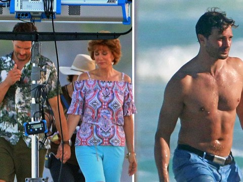 Unlikely couple Jamie Dornan and Kristen Wiig hold hands on beach stroll in scenes from new movie Barb and Star Go To Vista Del Mar