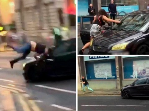 Driver sends man flying into lamppost after woman attacks his car with a shoe