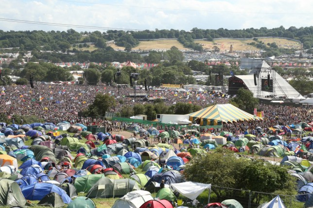 ? Licensed to London News Pictures. 30/06/2019. Glastonbury , UK. A big crowd watch acts on the Pyramid stage on the last day of the Glastonbury Festival in Somerset. Photo credit: Jason Bryant/LNP