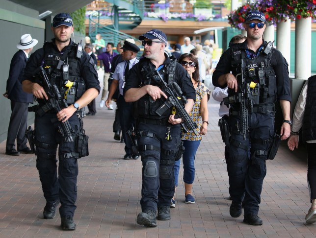 Armed police patrol the grounds on day two of the Wimbledon Championships at the All England Lawn Tennis and Croquet Club, Wimbledon. PRESS ASSOCIATION Photo. Picture date: Tuesday July 2, 2019. Photo credit should read: Philip Toscano/PA Wire. Editorial use only. No commercial use without prior written consent of the AELTC. Still image use only - no moving images to emulate broadcast. No superimposing or removal of sponsor/ad logos. Call +44 (0)1158 447447 for further information.