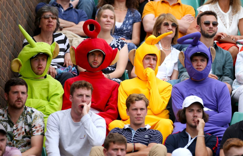 Spectators in the stands dressed as Teletubbies on day two of the Wimbledon Championships at the All England Lawn Tennis and Croquet Club, London. PRESS ASSOCIATION Photo. Picture date: Tuesday July 2, 2019. Photo credit should read: Steven Paston/PA Wire. RESTRICTIONS: Editorial use only. No commercial use without prior written consent of the AELTC. Still image use only - no moving images to emulate broadcast. No superimposing or removal of sponsor/ad logos.