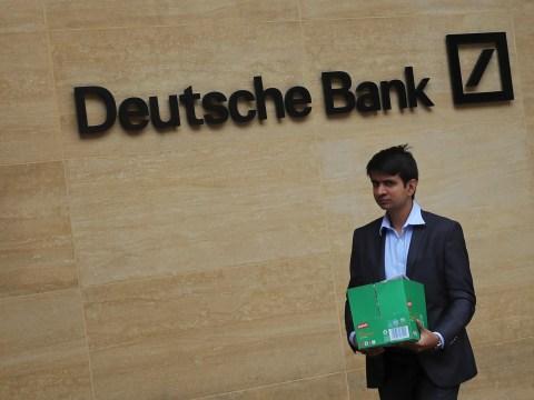 Tearful Deutsche Bank staff clear their desks as company cuts 18,000 jobs