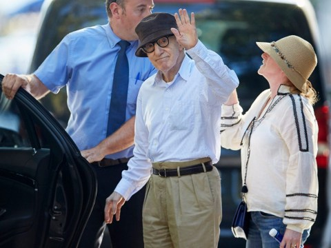 Woody Allen gives a wave after vowing never to retire as he shoots new movie with Christoph Waltz