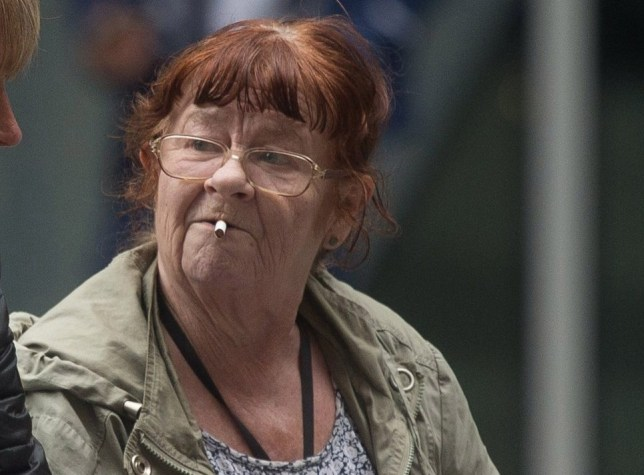 Pensioner Christine Roles smoking a cigarette outside Manchester Magistrates court