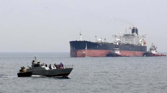 epa07709521 (FILE) - An Iranian military boat patrols next to the Artavil oil tanker, at the Kharg Island, in Persian Gulf, southern Iran, 12 March 2017 (reissued 11 July 2019). Reports on 11 July 2019 state British frigate HMS Montrose warned Iranian boats believed to belong to Islamic Revolution Guard Corps (IRGC) of Iran that allegedly tried to impede the British Heritage tanker near the Gulf. HMS Montrose took position between the boats and the tanker while training its guns on the boats reports state. The vessels then left the scene with no shots being fired on either side. Islamic Revolution Guard Corps (IRGC) has denied any involvement. EPA/ABEDIN TAHERKENAREH