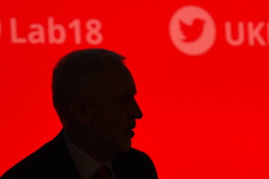 Opposition Labour party leader Jeremy Corbyn is seen in silhouette on the third day of the Labour party conference in Liverpool, north west England on September 25, 2018. (Photo by Oli SCARFF / AFP) (Photo credit should read OLI SCARFF/AFP/Getty Images)