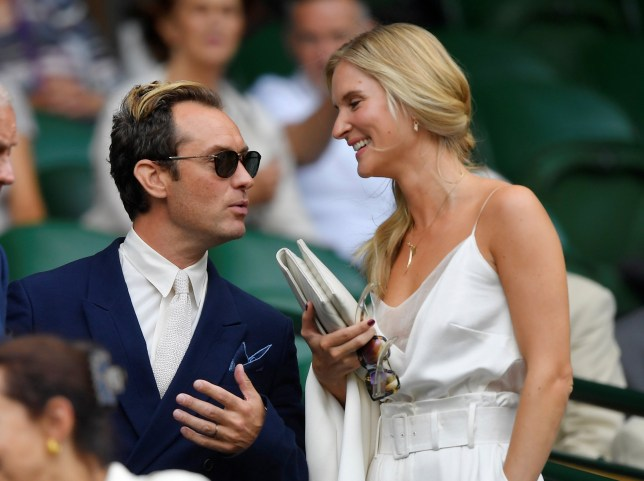 Tennis - Wimbledon - All England Lawn Tennis and Croquet Club, London, Britain - July 12, 2019 Jude Law and wife Phillipa Coan in the royal box before the semi-final match between Serbia's Novak Djokovic and Spain's Roberto Bautista Agut REUTERS/Toby Melville