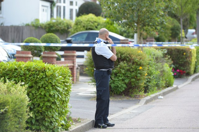 ? Licensed to London News Pictures. 15/07/2019. London UK: Police officers close off Malvern Drive in Woodford Green, Essex after a male in his forties was found with gun shot wounds and rushed to hospital, where his condition is described as critical , Photo credit: Steve Poston/LNP