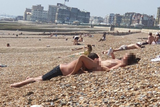 Couple Perform Sex Act In Front Of Families On Beach In -3202