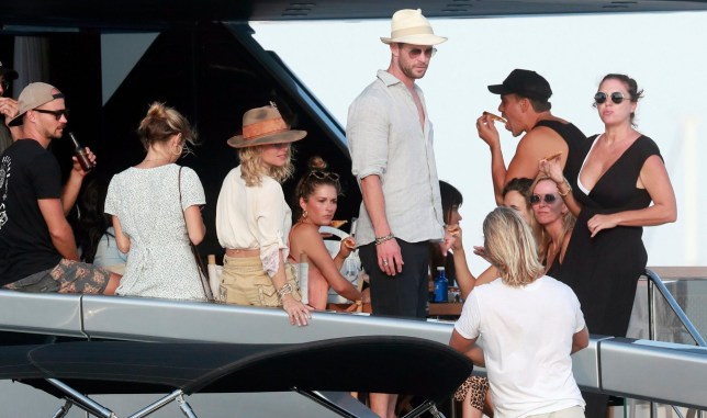 Chris Hemsworth surrounded by pizza and beer in Ibiza as he parties with Matt Damon after strict diet is revealed