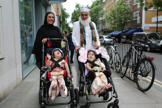 Undated handout photo issued by Great Ormond Street Hospital of two-year-olds Safa and Marwa Ullah, from Charsadda in Pakistan, leaving hospital after a surgery to separate their heads at the hospital in London, with their mother Zainab Bibi and their grandfather Mohammad Sadat. PRESS ASSOCIATION Photo. Issue date: Monday July 15, 2019. The sisters, who were craniopagus twins, underwent three major operations to separate their heads at Great Ormond Street. The last operation, which saw the girls finally separated, took place on February 11 this year. See PA story HEALTH Twins. Photo credit should read: Great Ormond Street Hospital/PA Wire NOTE TO EDITORS: This handout photo may only be used in for editorial reporting purposes for the contemporaneous illustration of events, things or the people in the image or facts mentioned in the caption. Reuse of the picture may require further permission from the copyright holder.