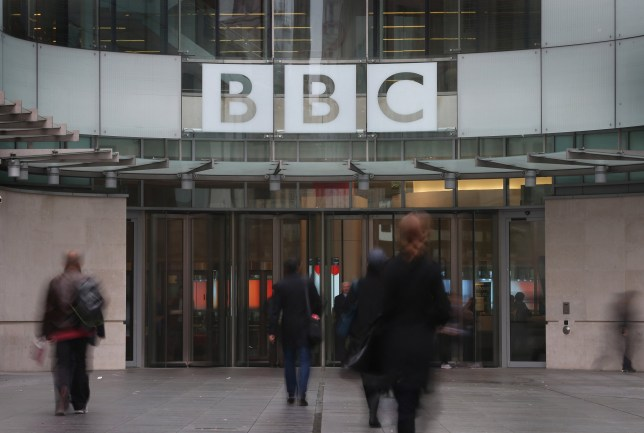 LONDON, UNITED KINGDOM - OCTOBER 22: People walk near the entrance to BBC Broadcasting House on October 22, 2012 in London, England. A BBC1 'Panorama' documentary to be broadcast later tonight contains new allegations about the handling by BBC2 programme 'Newsnight' concerning claims of sexual abuse allegedly carried out by fomer BBC television presenter, Jimmy Savile, the transmission of which was subsequently dropped. Police have confirmed that Sir Jimmy Savile, the BBC presenter and DJ who died in October 2011 aged 84, may have sexually abused young girls on BBC premises. (Photo by Peter Macdiarmid/Getty Images)