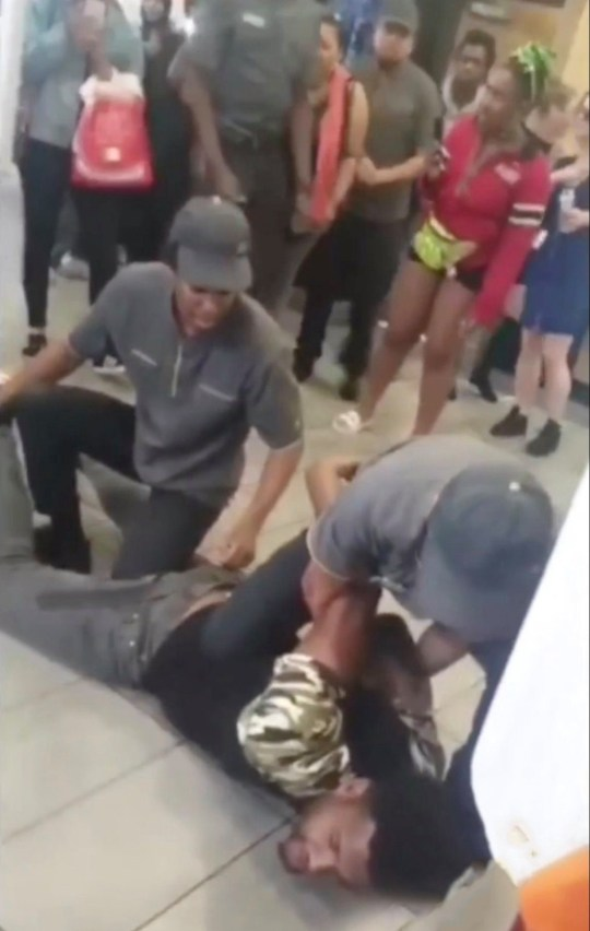 A wannabe gangster claiming to be a member of the notorious Burger Bar Boys gang in Birmingham is restrained by other McDonald's workers in a branch of the fast food restaurant Brixton, London, Sunday 14th July, 2019.