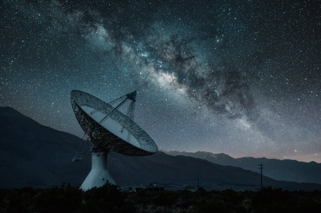 Milky way rising behind Radio Telescope Observatory
