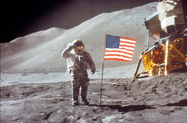 060280 01: Astronaut David Scott gives salute beside the U.S. flag July 30, 1971 on the moon during the Apollo 15 mission. (Photo by NASA/Liaison)