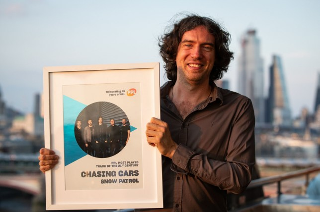 EMBARGOED TO 0001 WEDNESDAY JULY 17 Frontman of Snow Patrol Gary Lightbody receives the award for Most Played song of the 21st century, according to music licensing company PPL for his band's record, Chasing Cars, at the Oxo Tower, London. PRESS ASSOCIATION Photo. Picture date: Tuesday July 16, 2019. Photo credit should read: Aaron Chown/PA Wire