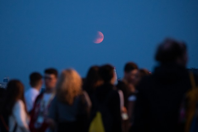 The moon rises over London, as viewed from Primrose hill, as a partial lunar eclipse is occurring on the 50th anniversary of the Apollo 11 space mission. 16 July 2019.
