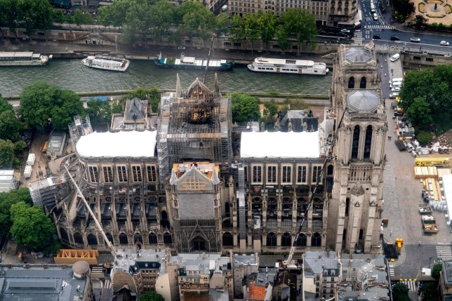 """(FILES) This aerial file photo taken on June 12, 2019 in the French capital Paris shows the Notre-Dame de Paris cathedral under repair after it was badly damaged by a huge fire. - Local authorities in Paris have ordered a """"deep clean"""" at schools around the fire-damaged Notre-Dame cathedral, a city official said on July 18, 2019, following a media report claiming the extent of contamination has been covered up. Paris health official Arnaud Gauthier said that the cleaning had been ordered """"to reassure us that the risk is minimal,"""" adding that the levels of lead pollution caused by the April fire at Notre-Dame were not a cause for alarm. (Photo by Lionel BONAVENTURE / AFP)LIONEL BONAVENTURE/AFP/Getty Images"""