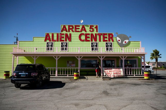 epa07728498 A man enters the 'Area 51 Alien Center' building, a shop and diner where more than 1.5 million people have decided to gather to 'storm' the Area 51, in Amargosa Valley, Nevada, 19 July 2019. More than 1.5 million people have responded to a gathering, launched on social media, to 'Storm Area 51'. The US army has already given a statement that they would use any means necessary to prevent anyone accessing the area. EPA/ETIENNE LAURENT